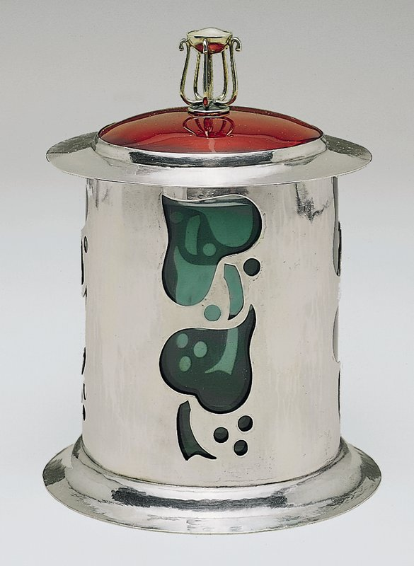 Cylindrical form with heart-shaped leaves and berries motif (cut-outs) with domed lid in crimson enamel; the finial is sterling wirework with a blister pearl set in a bezel