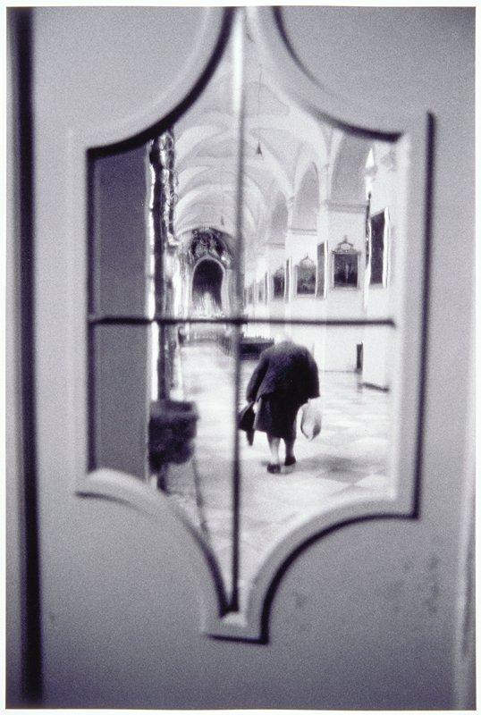 view of stooped women through window