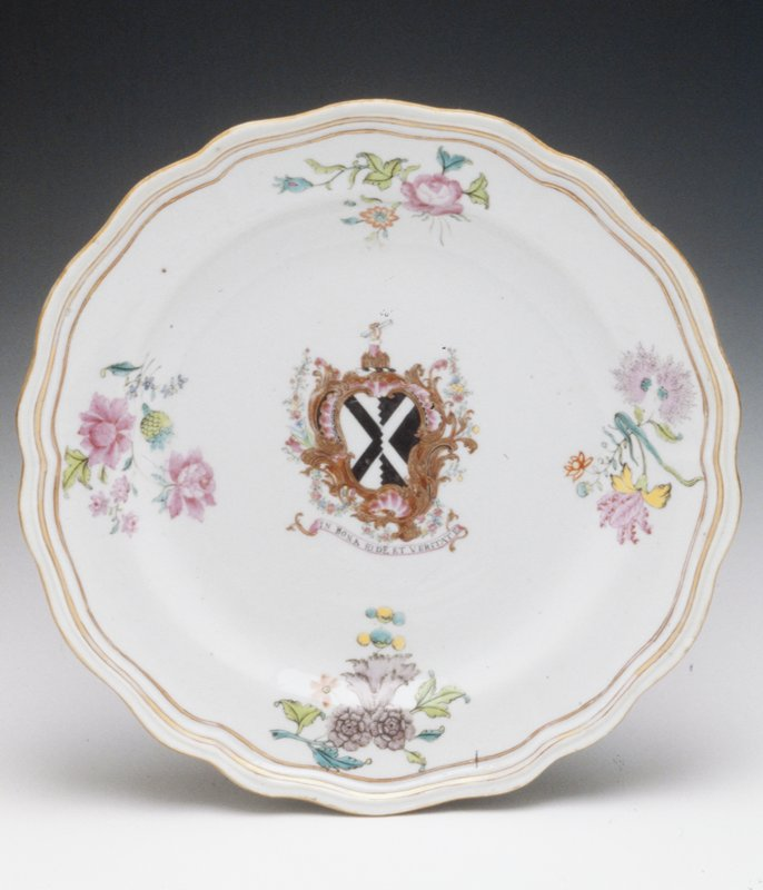white glaze, centerfield with Coat of Arms of Scott, motto 'in Bona Eide et Veritate', border with floral sprays in colors, shaped rim with gilt and rust thread trim