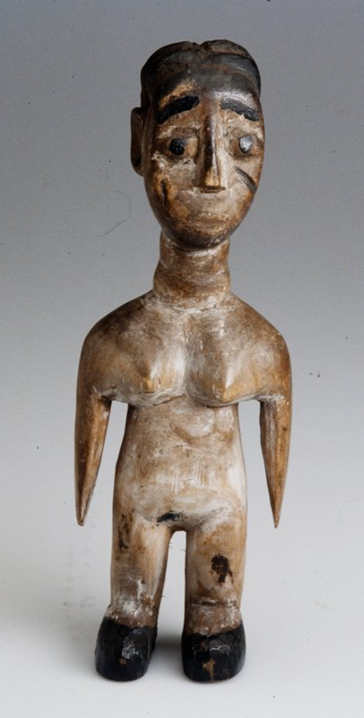 Wooden female figure with overall white patina; black hair, facial features, and shoes