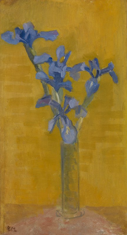 Vase of irises on table with yellow background