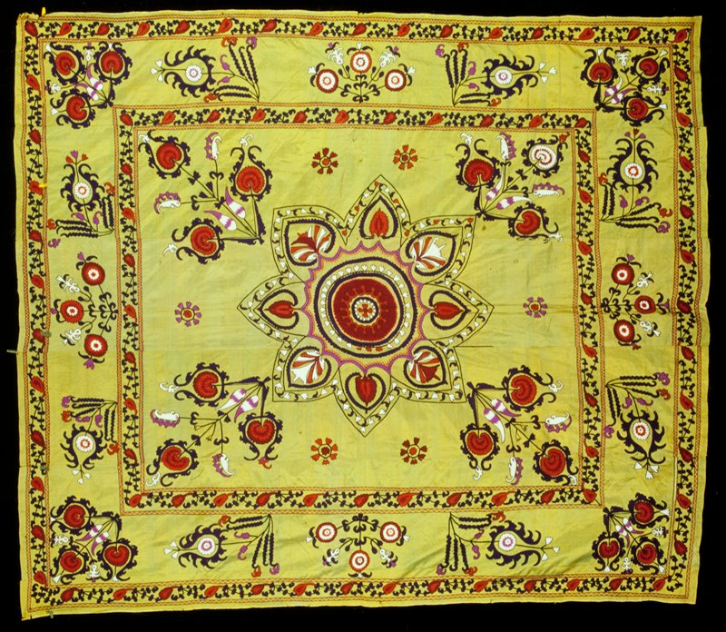 lime green background; embroidered flowers; central motif and border in black, red, orange, purple and white