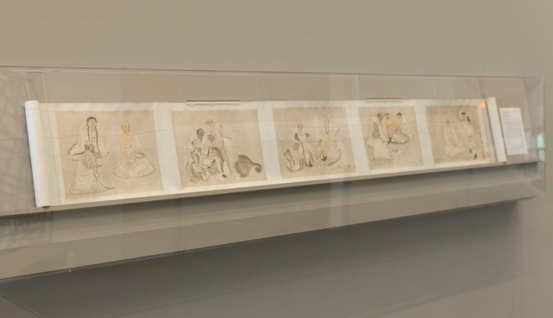 nine black, grey, brown and flesh-tone drawings of men, attendants and animals; text panels at front and back