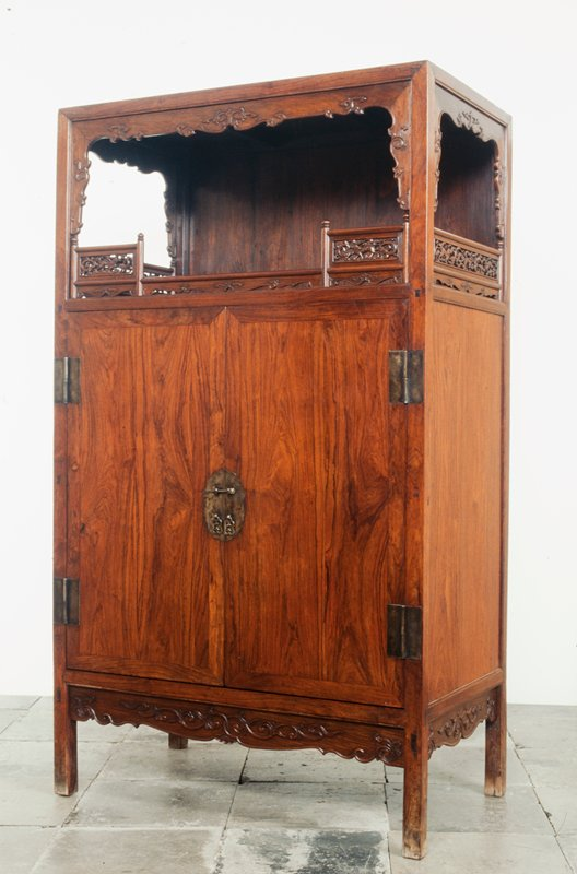 cabinet with open gallery on top, carved with openwork clouds and lions along lower edges; pair of hinged doors below with 2 shelves and 3 drawers on interior