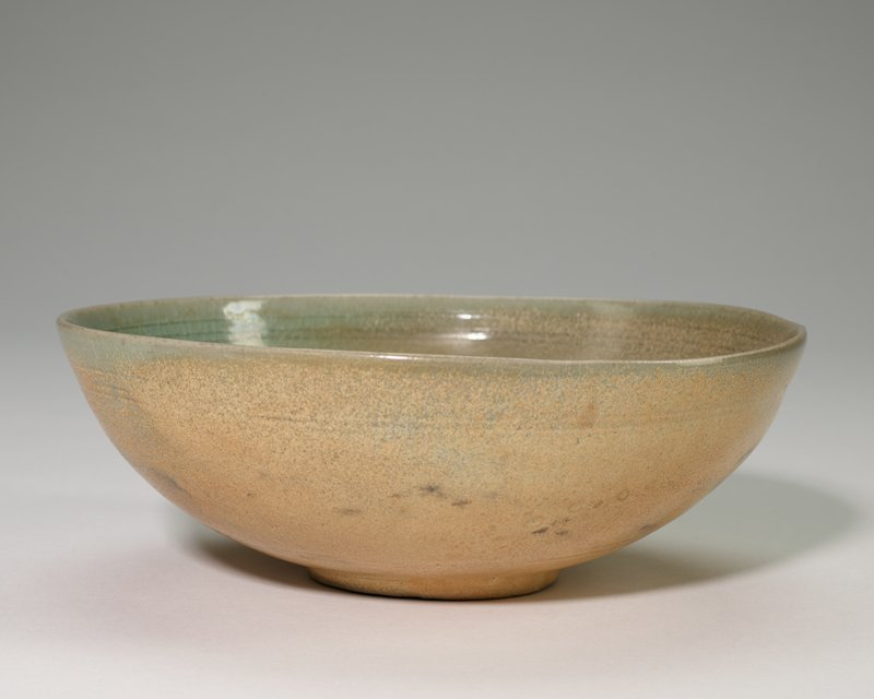 Bowl, shallow buff color outside and gray green glaze inside three incised lines near rim.