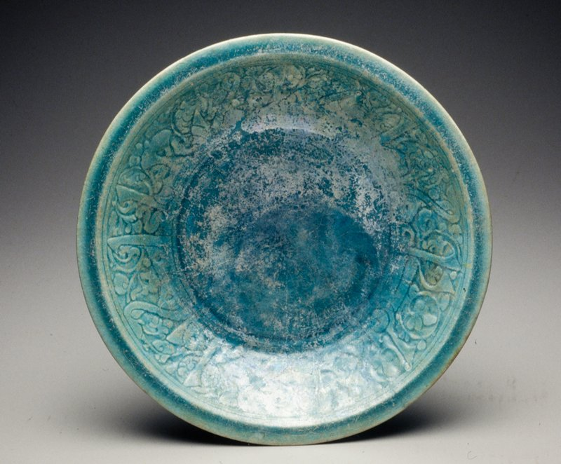 incised decoration on inner surface with turquoise luster glaze