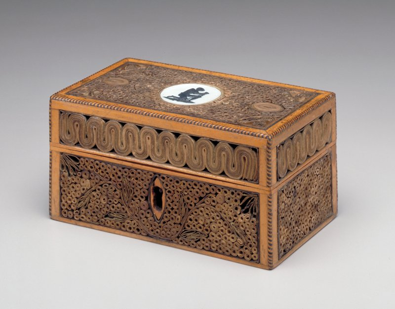 Rare rolled paper decorated traveling writing box, fitted with a 'slave' medallion, Wedgwood, c.1787. The interior of the box is fitted for writing tools and retains its original salmon colored paper. England, c.1790; noteper Lotus Stack, Textile curator,'interior paper' is actually silk fabric.