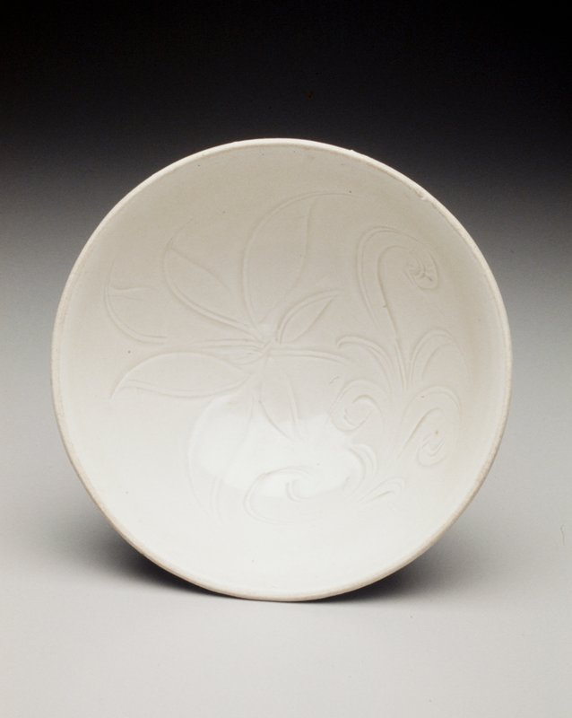 small ivory bowl, lotus blossom inside well with circular foot on bottom