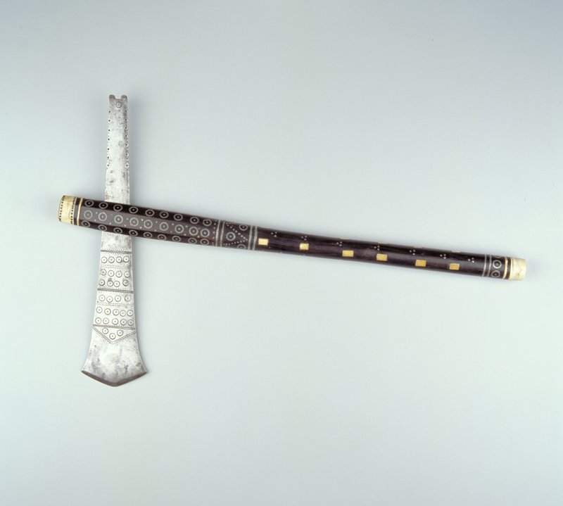 wood handle with inlaid metal and ivory decoration, including metal circles and ivory rectangles; incised decoration on blade; rear edges of blade decorated. [Culture given as 'Malawi - FLB 03/15/2016]