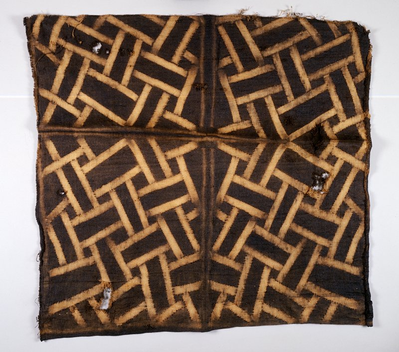 stick-resist dying technique; brown and white; rectangular and square patterning; two unfinished edges