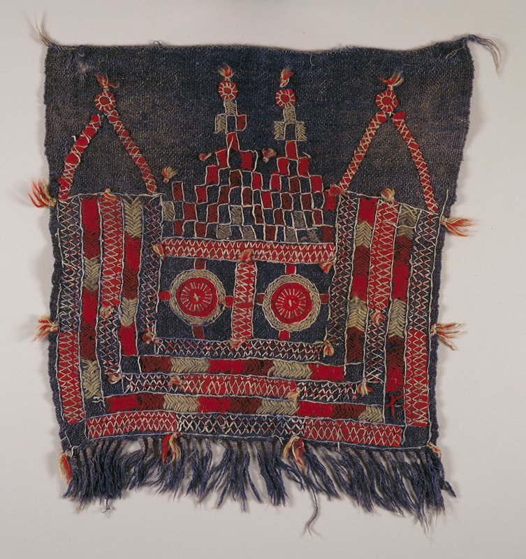 SO/embroidery; square panel with fringe along one edge; blue field embroidered banding along three sides, two red circles radiating cross behind; two pyramids created by rectangles placed corner to corner in light blue and red