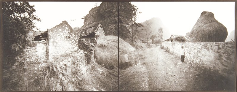 Two photographs printed next to each other; ruined stone building with hay bale at right edge in left image; stone wall with boy leaning against it at right, ghostly children leaning against hay bale at left in right image; matted