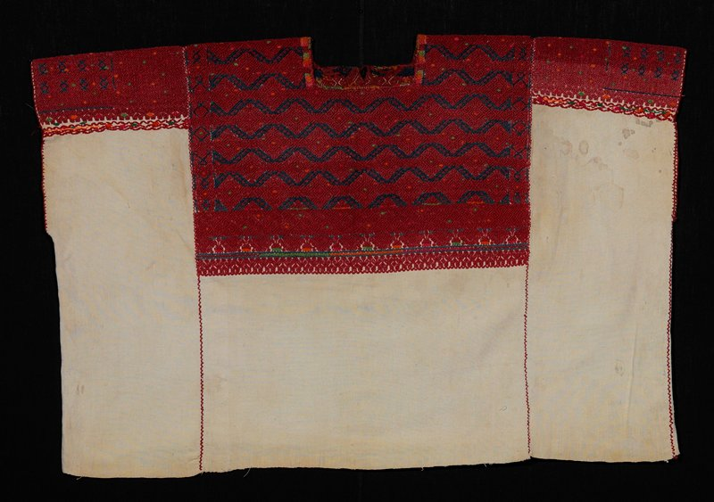 three-paneled white cotton huipil; red and blue cotton brocaded design