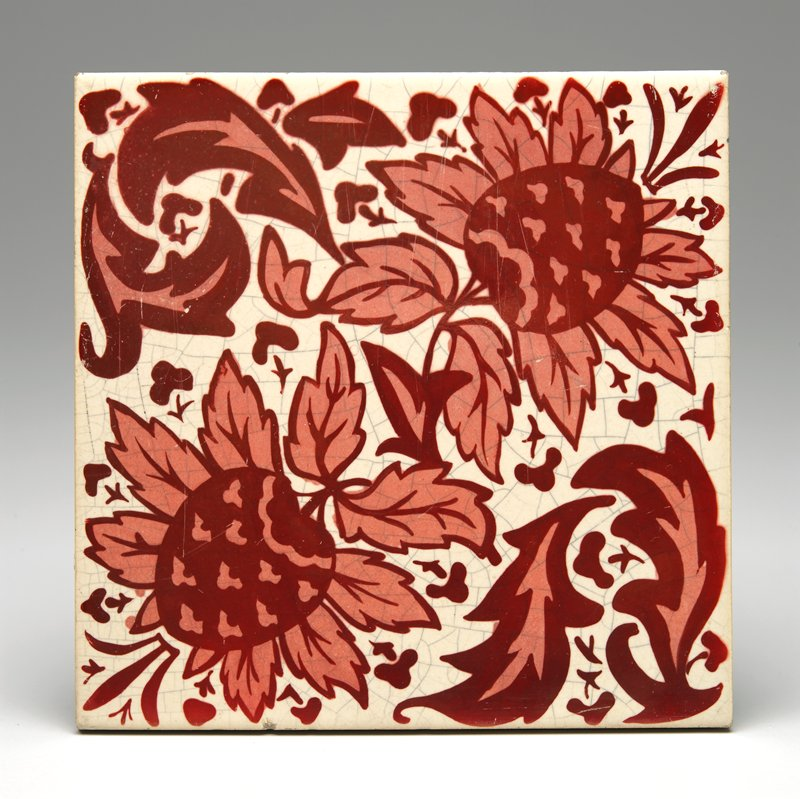 red and pink on cream; large floral and leaf design and bird