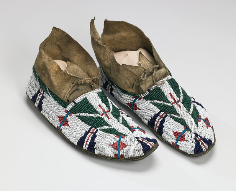 rawhide soles; tanned uppers; beaded with geometric designs in blue, green, red and white overall on tops