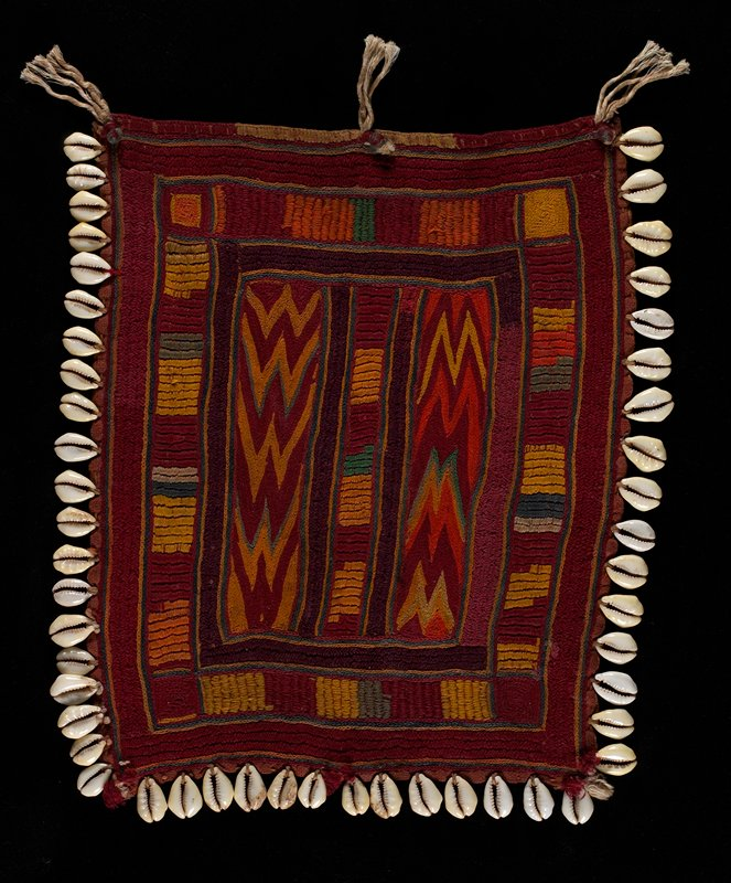 red, orange, yellow, green, purple, blue and grey; embroidered lines and zigzags in strips; edged on 3 sides with cowrie shells