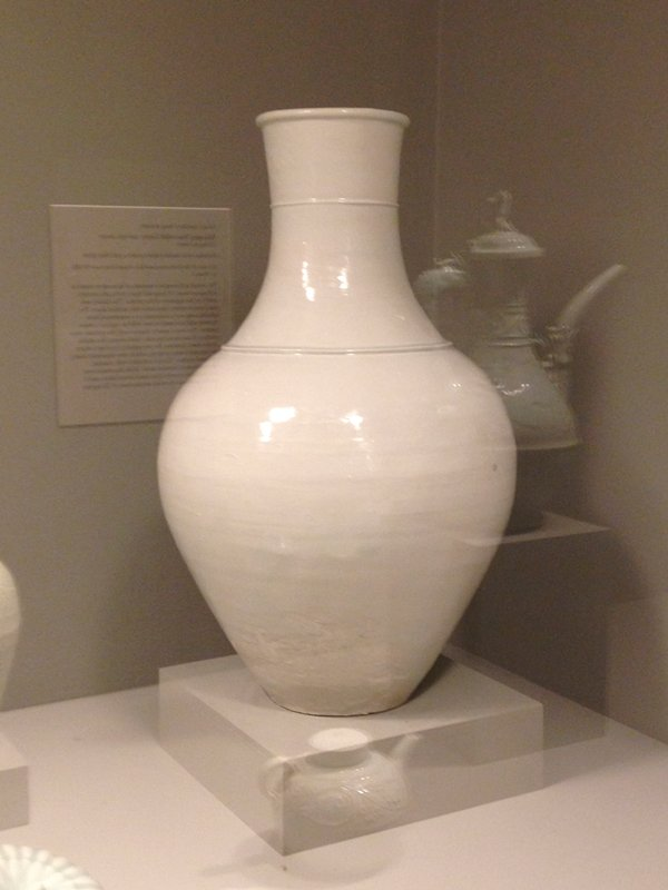 large vase with flat foot, outward-flaring shoulder; tapering thick-walled neck with 2 rings; pale blue glaze