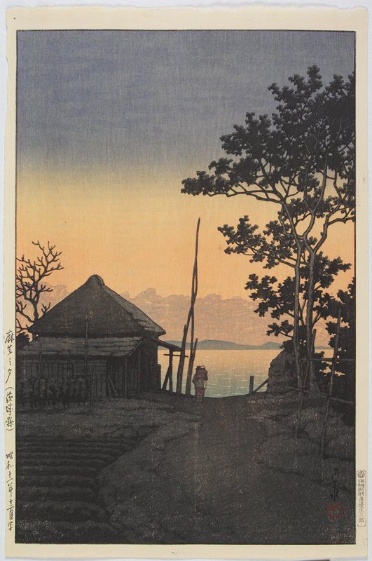landscape; sunset with mountains in background, water in middle ground; figure on path next to building at L; trees at R