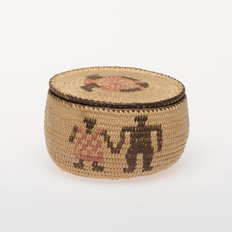 Miniature round basket with cover; coiled. Design consists of pairs of human figures in red and black.