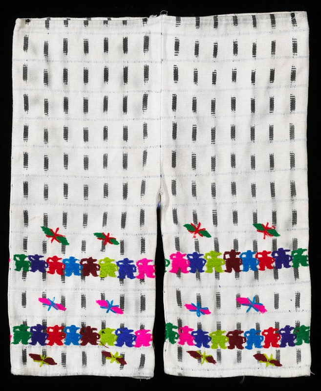 Possibly belongs with 2002.280.53 and 54 as a costume. White cotton pants with black vertical ikat and fine blue warp within ikat; embroidered with butterflies and human figures.