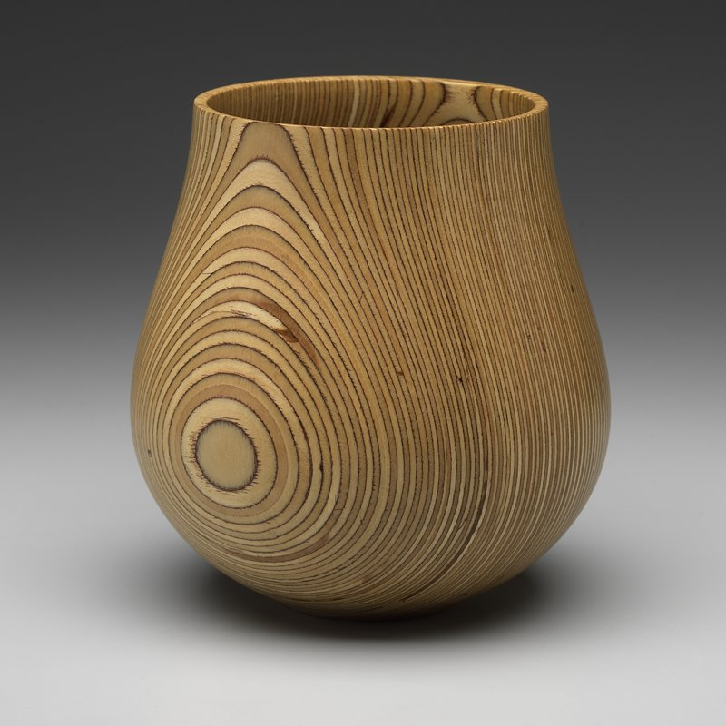 roughly tulip-shaped; flat base; fused layers of light-colored wood