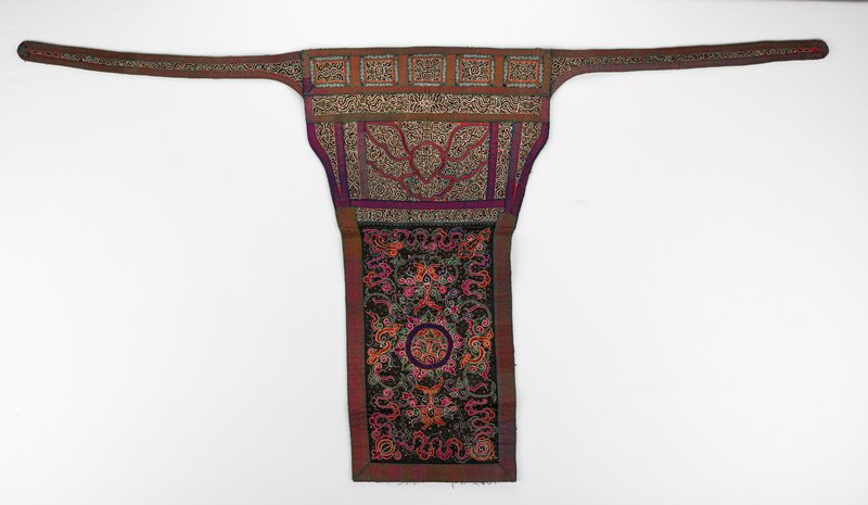 blue backing; green and red, and pink and blue trim; panels and strips embroidered with scrolling, organic designs, edged in white, interspersed with copper-colored sequins