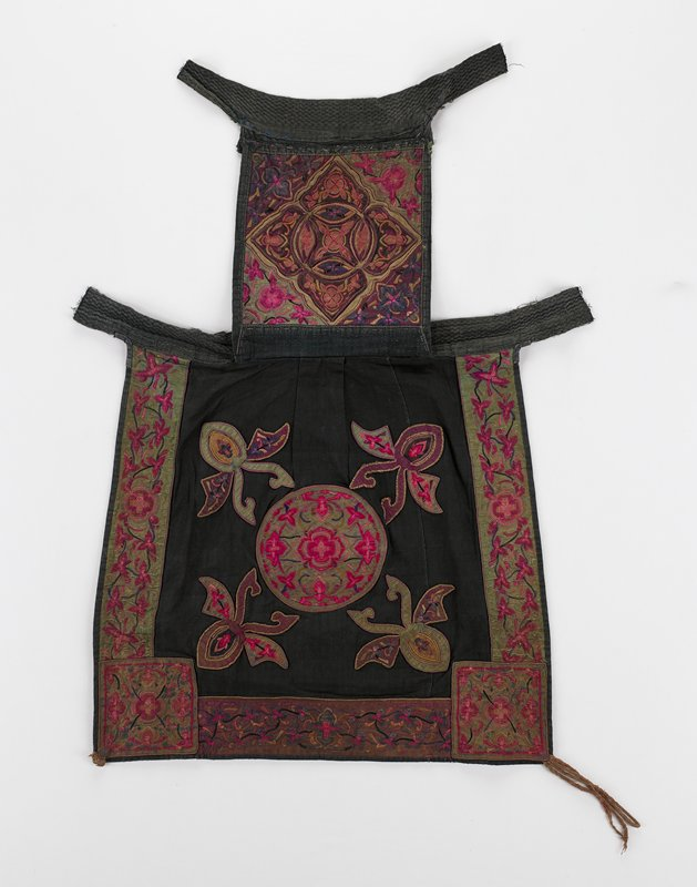 black ground; top section has central medallion with organic and floral patterns; three sides of bottom section bordered with floral applique; central embroidered applique on bottom section surrounded by four organic, insect-like shapes; greens, blues, maroon, pink and purple