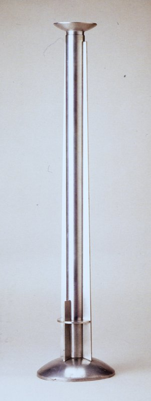 candlestick with metal cross decoration at bottom