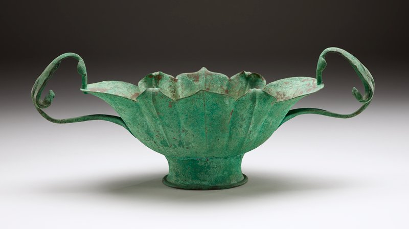 Handwrought copper, patinated in a verde green; looping handles with foliate-organic details