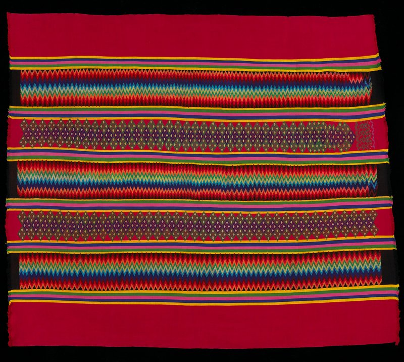 Two panels sewn together; supplementary weft patterning in red, black, yellow, green, pink, blue stripes and diamonds.