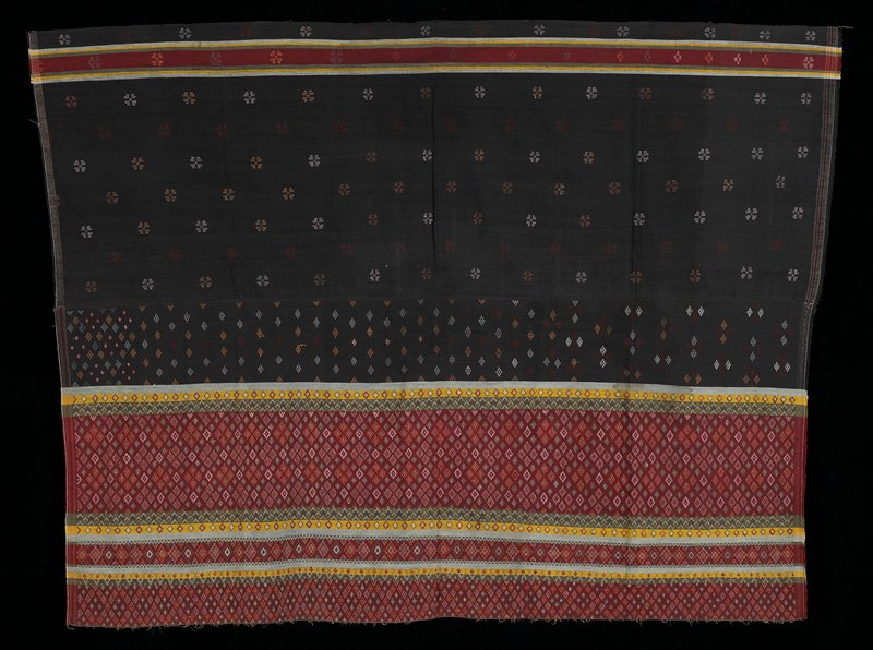 """Two panels sewn together; 24"""" high, plain black with spaced motif; the other part is burgundy with green, yellow, white, orange diamond motifs."""
