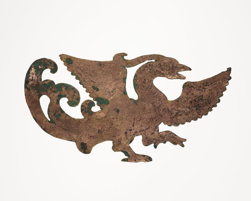 walking bird with wings outstretched; inward-curving tail-feathers; facing R; mounted on black cloth-covered board with L2003.116.7.1, 3