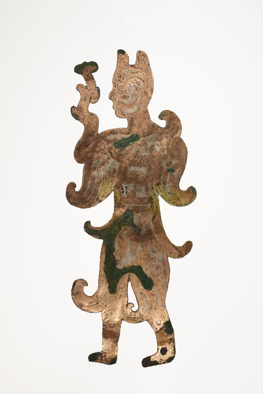 standing figure holding a flower-like object; facing L; incised details; mounted on black cloth-covered board with L2003.116.10.2
