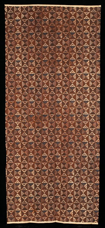 brown and blue on cream; pattern of triangles filled with geometric and floral organic designs