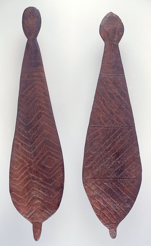 Paddle-shaped object; small protrusion on widest end; decorated with incised hatched diagonal bands separated into three sections