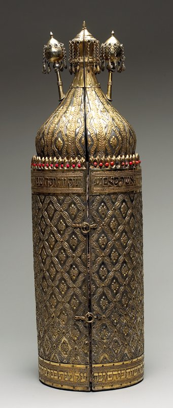 gold and silver patina; gold bands with text in relief at top and bottom of cylindrical portion; diamond floral designs; orange beads at top of cylinder; top finial and removable finials have pendant bells on chains
