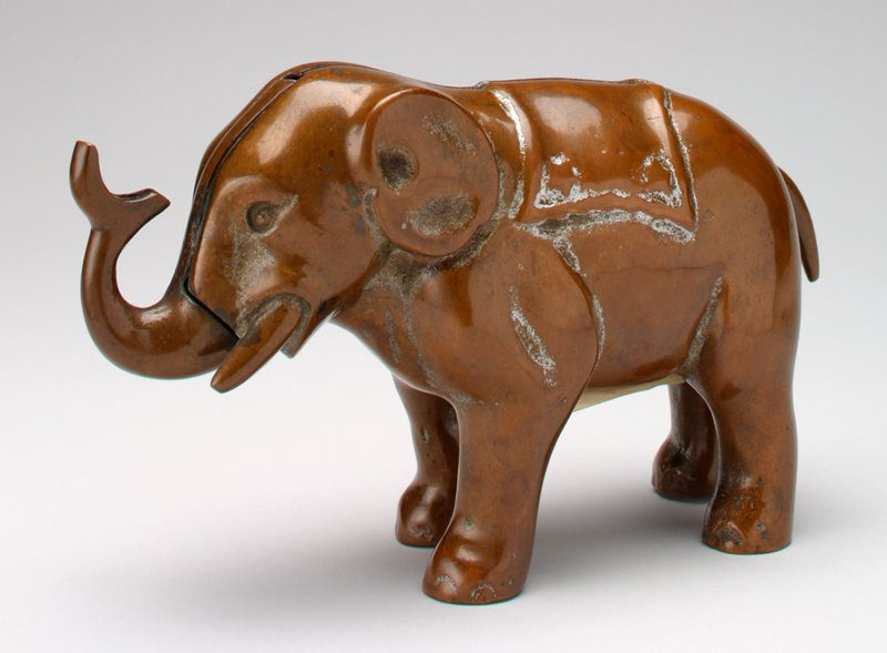 very heavy brass elephant; push tail, trunk moves up
