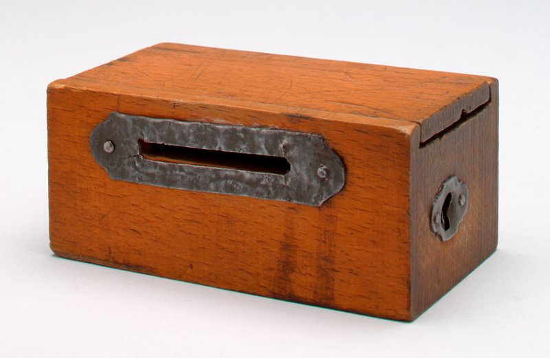 small rectangular wooden box bank with sliding top; metal keyhole to inside metal locking mechanism; metal reinforced coin slot held on by 2 small metal nails