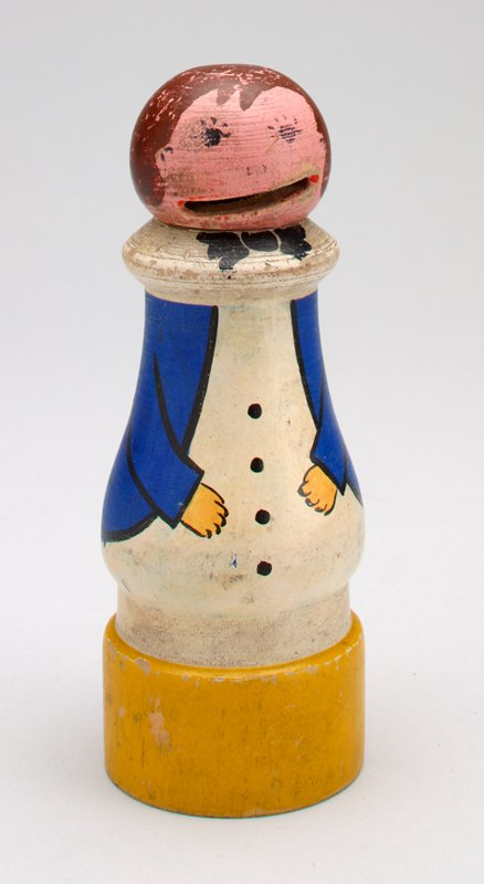 cylindrical figure; painted; yellow base; white shirt (?); blue coat; head is removable; coin slot mouth