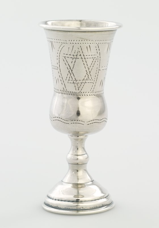 small footed cup; cup has rounded bottom, flaring in and outward again toward outward-rolled lip; decorated with zigzag and curved lines and star of David