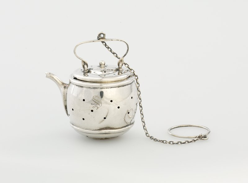 teapot shaped; chain with ring attached to handle on cover