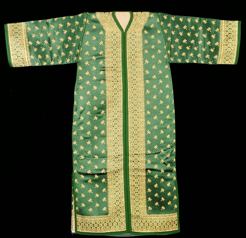 green ground with gold patterning. Falling leaf pattern. Mohammad Ben Cherif, weaver; Lachen Barakat, tailor. Woven fabric