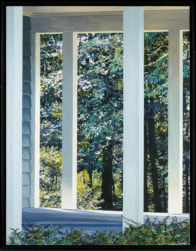 three white columns on a porch, with siding visible at L; view between columns of bright, dense trees and foliage
