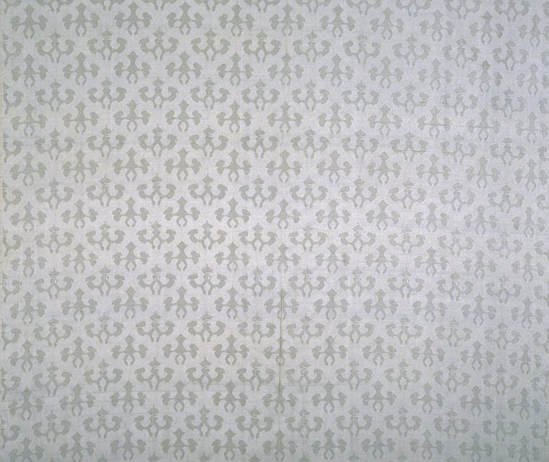 "Leno brocade. Plain weave ground. Two Fleur de Lis type designs in staggered, alternating rows. 7.50"" Pat. rpt. (beige)"