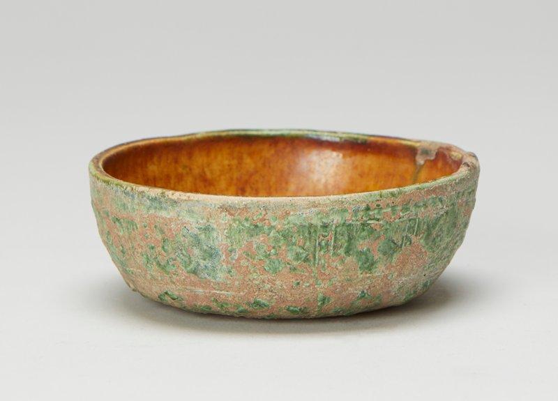 Dish, small, brown, glaze, irridescent; green lead glaze outside irridescent. White earthenware.