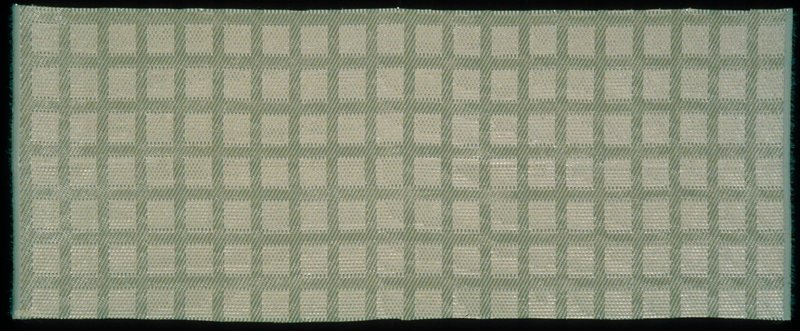 """Polyester pile variation with eyelash effect. The breaking of light in """"eyelashes"""" of different width makes rows of 1 1/2"""" squares visible. Sheer. Vert. Rpt. 3""""; horiz. 2.5"""". Pale green. Agate"""