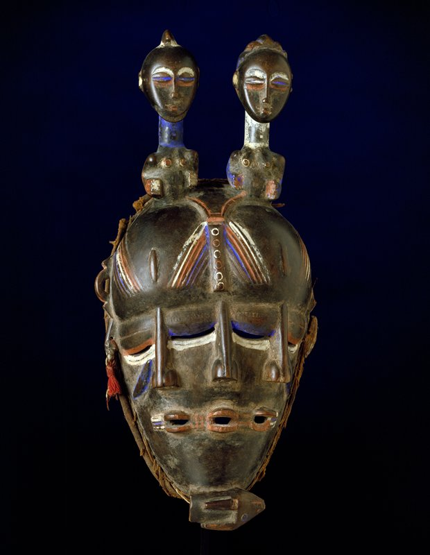 triple-faced dance mask; wood, red, blue and white pigment; with stand