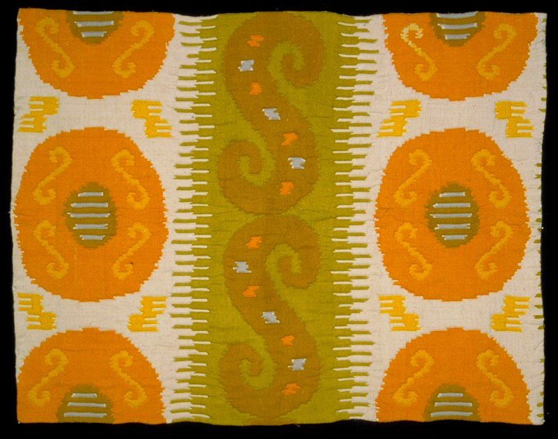 """Handwoven & handprinted with 16"""" pomegranite like designs separated by 19"""" """"Lazy S"""". Vert. rpt. 36""""; horiz. 18.75"""". gold on shades of gray. Lemon Peel"""