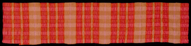 Handwoven silk shibori cloth with regular pattern of vertical pale brown and orange-red bands of varying width. Handwoven silk shibori cloth with regular pattern of vertical pale brown and orange-red bands of varying width. Cayenne