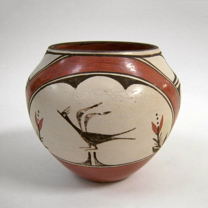 small, thick-walled vessel; decorated with twice-repeating pattern of bird and 2 flowers and geometric designs in red, brown and cream